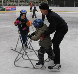Ben helping students ice skate
